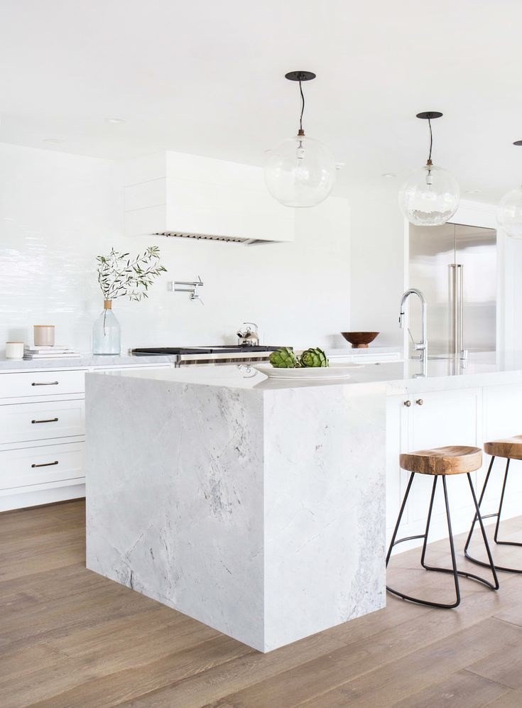 A waterfall counter top turned traditional. This twist on the modern waterfall counter top provides an excellent separation of space between kitchen and bar.  | Tessa Neustadt Interiors
