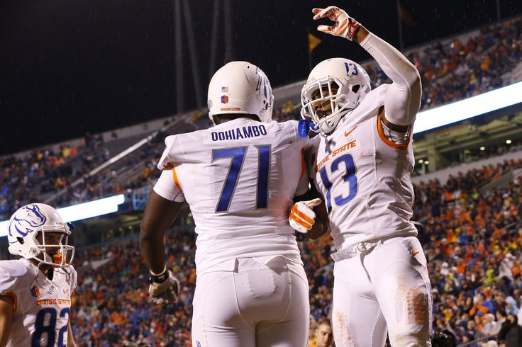Sep 25, 2015; Charlottesville, VA, USA; Boise State Broncos running back Jeremy McNichols (13) celebrates with Broncos offensive lineman Rees Odhiambo (71) after scoring a touchdown against the Virginia Cavaliers in the second quarter at Scott Stadium. Mandatory Credit: Amber Searls-USA TODAY Sports (3900×2600)