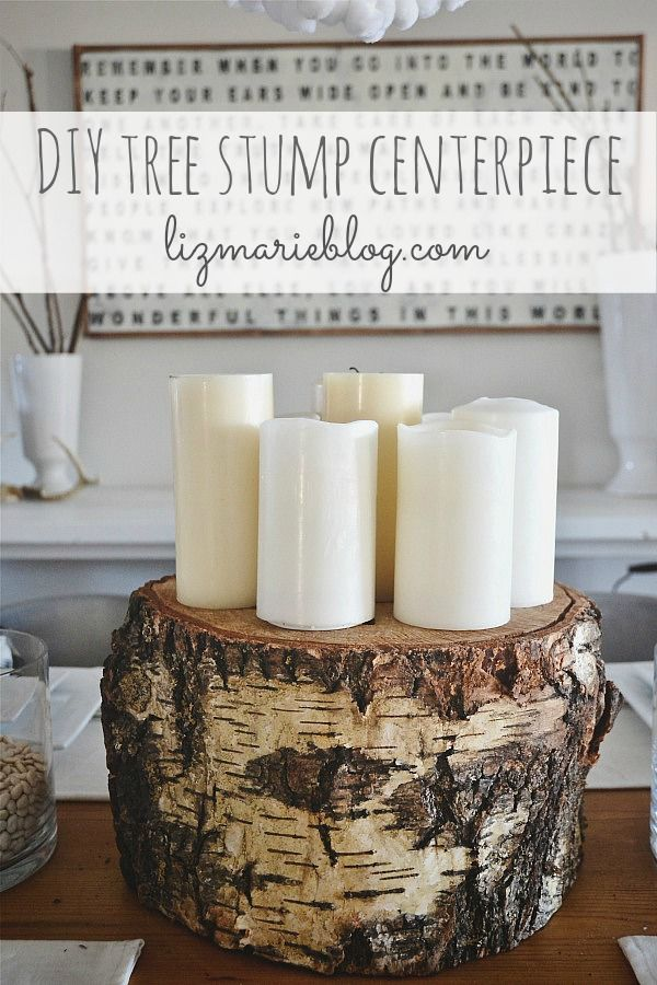 DIY Tree Stump Centerpiece. Since I now own a tree stump. add some garland, pinecones and berries..
