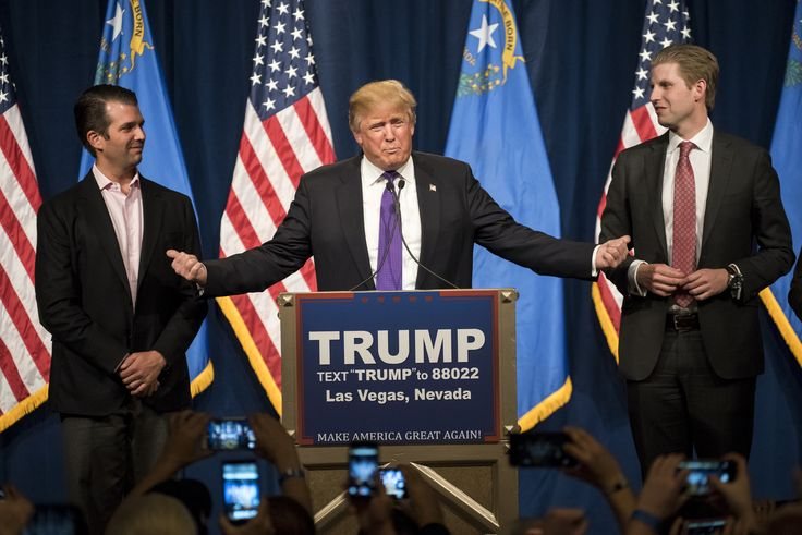Donald Trump, president and chief executive of Trump Organization Inc. and 2016 Republican presidential candidate, center, speaks as his sons Donald Trump Jr., left, and Eric Trump, right, listen during a caucus night rally in Las Vegas, Nevada, U.S., on Tuesday, Feb. 23, 2016. Trump's dominating victory in the Nevada caucuses pushes him further out ahead of his nearest competitors for the Republican presidential nomination, giving his unorthodox candidacy a major boost heading into Super…