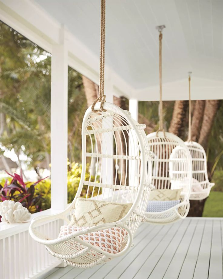 Hanging chairs on a covered porch.  Hanging Rattan ChairHanging Rattan Chair