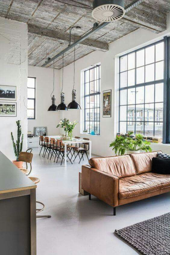 great room ideas that will last the test of time. Camel leather sofa, lots of greenery, and steel windows - this is an urban loft style design for your dream home.