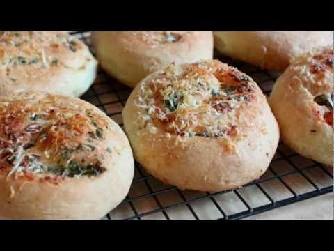 Nothing makes friends and family feel more special than homemade bread. Learn how to bake Garlic Parmesan Dinner Rolls in this video by Chef John from Foodwishes.com. This step by step walk through will have you baking like a pro in no time!