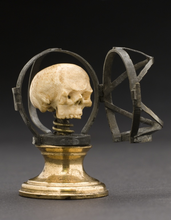 Skull behind an iron cage, from the 19th century
