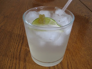 White Gummi Bear Drink Recipe 1 oz Berry or Raspberry Vodka1 oz DeKuyper Peachtree1 oz Sweet and Sour3-4 oz Sprite1 lime squeezeShake together Vodka, Peachtree, and S Pour into glass, top with Sprite and lime squeeze. The S and Sprite measurements are an estimate, adjust to your liking.