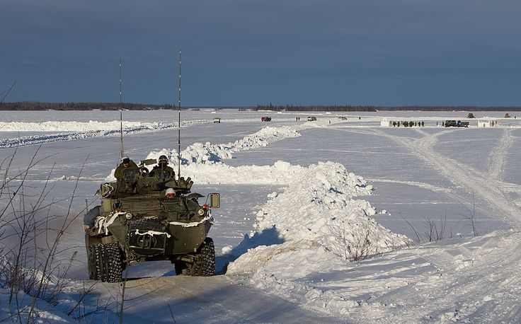 Canadian LAV Coyote drives up an ice road near Behchoko