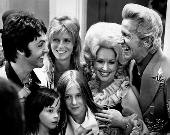 Paul and Linda McCartney and their children Heather and Mary, with Dolly Parton and Porter Waggoner. Just wow.