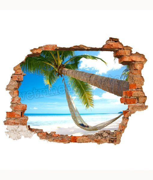 buco nella parete con dietro spiaggia tropicale