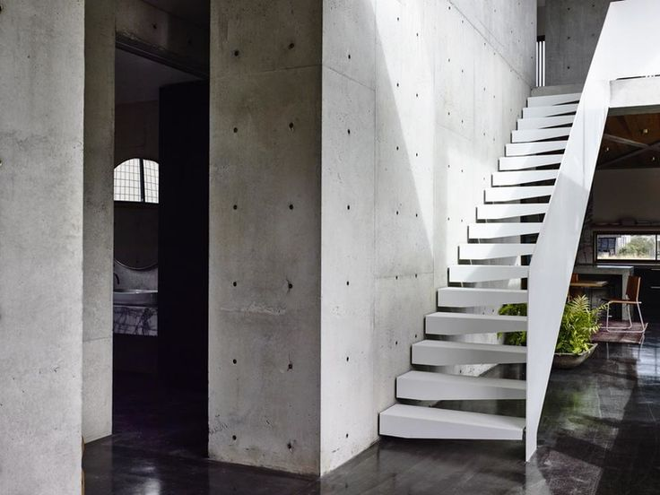 Auhaus Architecture and Interiors - Concrete House. Photo by Derek Swalwell