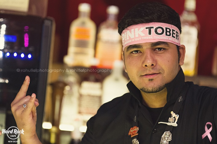 One of our boys posing a Pinktober bandana at Hard Rock Café New Delhi