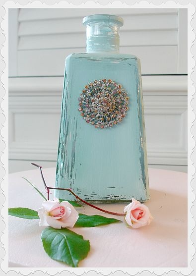 Painted bottle and upcycled brooch. I constantly save empty jars/bottles thinking I'm going to do something with them.