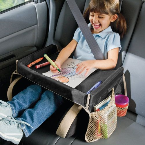 """Not all kids travel trays are crash tested, but this one is, and it passed with flying colors! It's filled with soft, firm foam that's rigid enough to color or snack on, but collapses safely on impact. The 2"""" rim keeps crayons contained. With waist strap, two toy pouches, and two cup holder pockets."""