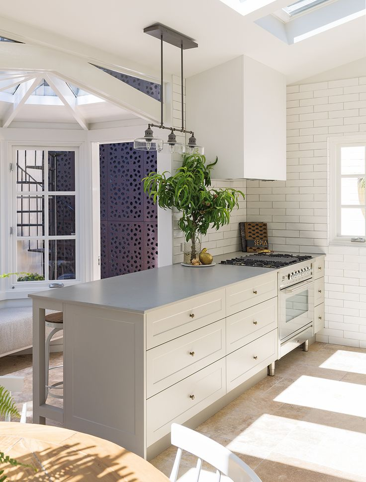 The shaker door profile is also a lovely detail to add to the cabinetry, as is the grey grout with the white tiles. The Block's Darren Palmer shares his own kitchen reno - The Interiors Addict