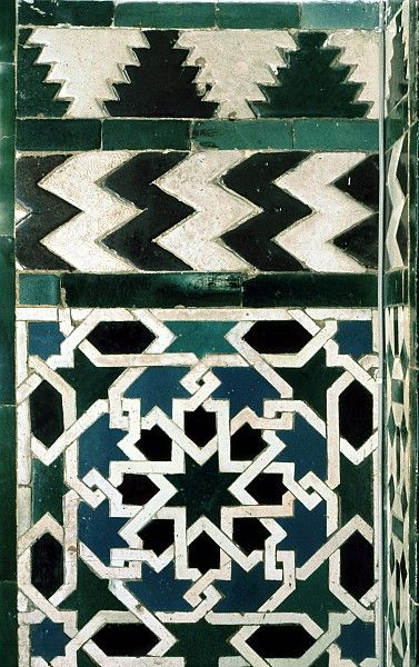 detail of decorated area from the Alcazar, in Seville, Spain, showing Geometric Pattern using ceramic tiles, mosaic or pottery.