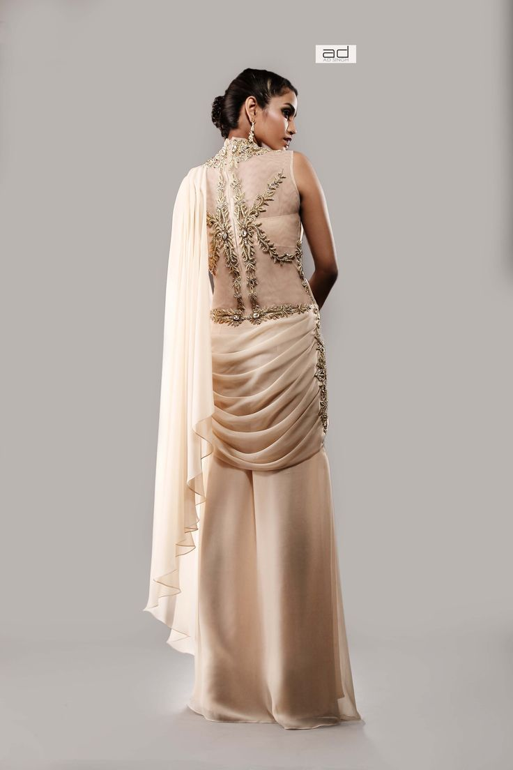 Indian Pre Stitched Gown saree with a sheer back and intricate gold embroidery in zardosi and crystal dust. for more info email: Info@adsingh.com www.twitter.com/adsinghdesigns www.facebook.com/adsinghdesigns