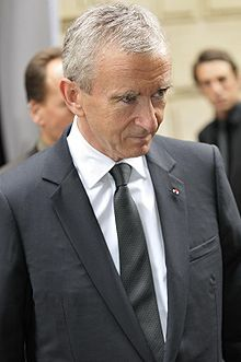 Bernard Arnault, a business magnate, art collector, owner of Groupe Arnault SAS, a principle investment firm.  The firm seeks to hold stake in companies.  He is also Chairman & CEO of LVMH since 1989.  LVMH Moet Hennesy owns Givenchy brand label and other brands. LVMH Group is also involved in culture, heritage, humanitarian, education,support of young artists/designers.