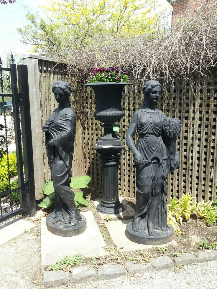 Cast iron woman statues and large urn