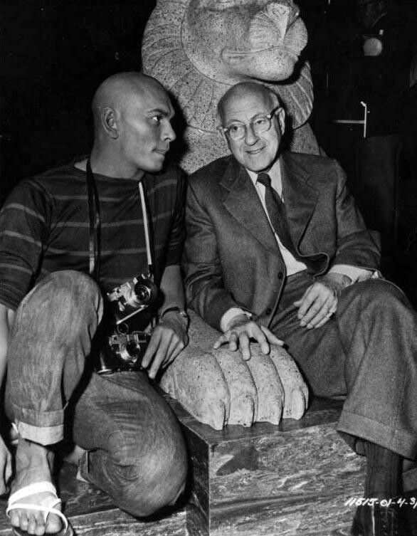 Yul Brynner and Cecil B. de Mille on the set of The Ten Commandments