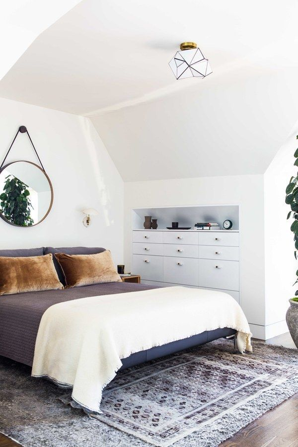 The Houseu0027s Attic Was Converted Into A Master Suite Where BDDWu0027s Captainu0027s  Mirror Takes The Place Of A Headboard. A Mohair Rug From Holland U0026 Sherry,  ...