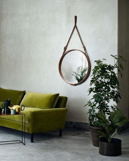 green sofa + grey walls