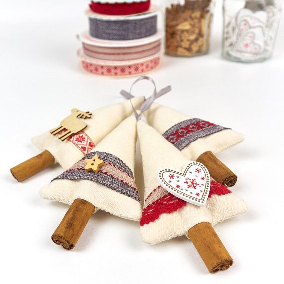Bring the seasonal fragrance of cinnamon into your home this holiday season with these special cinnamon stick Christmas tree decorations. Perfect to string along a mantlepiece (preferably above a roaring fire!) or would make a lovely hostess gift. Made from a simple, primitive country style, calico and embellished with ribbons, buttons and decorative stitching in shades of red and grey. The tree trunks are made from top quality culinary grade cinnamon that gives off a lovely fragrance. The…