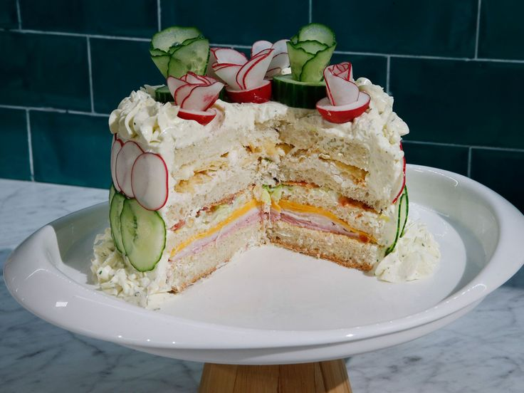 Sandwich Cake : Though this layered masterpiece may look like a showstopping dessert, it's actually a savory sandwich, piled high with deli meats and cheeses, then spread with a ranch-flavored cream cheese mixture to mimic frosting.