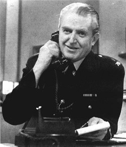 """The policemen (more Jack Warner than Jack Hawkins), slow to spring into action, were now ready with their, """"Come along, Sir. You're causing an obstruction."""" Graham pointed. """"My daughter,"""" was all he could manage. Glances that said 'You poor devil' were exchanged. They obviously thought the worst. Who wouldn't? Crossing the junction, one of the officers began to direct traffic around the two abandoned vehicles. ('Dixon Of Dock Green'. Played by Jack Warner.)"""