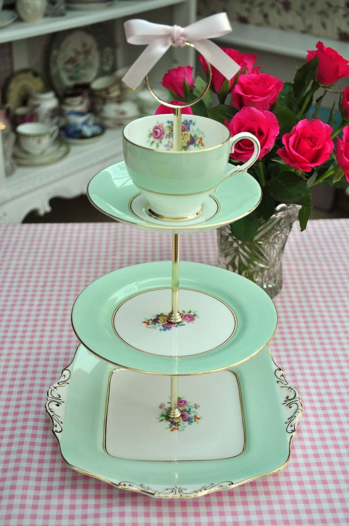 Vintage china tiered stand topped with tea cup. Could give as shower gift (and use as buffet decoration) for family member made from day grandmother's china (especially to share a pattern across the family or if you don't have enough pieces to set a table).