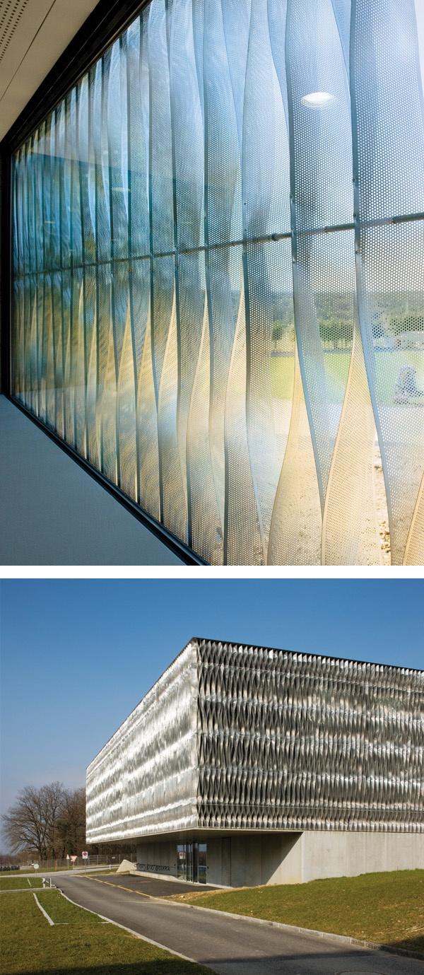 perforated metal facade. Bure Military Training Base