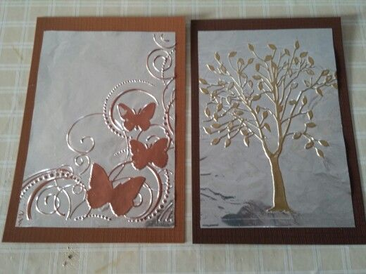 Using an embossing folder I embossed heavy duty aluminum foil. While still in folder, I de-static, roll on Versa Mark with a brayer. Add embossing powder, shske off excess. Use a small paint brush clean up any loose powder. Carefully remove from folder, use heat tool to set.