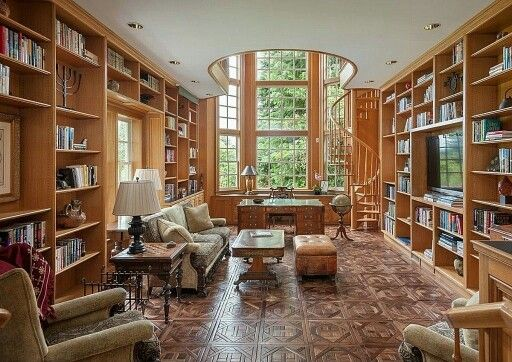 Beautiful home library with floor-to-ceiling windows and natural light