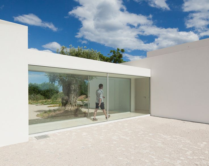 rooms connected by glass hallways | vitor vilhena: house in tavira, portugal