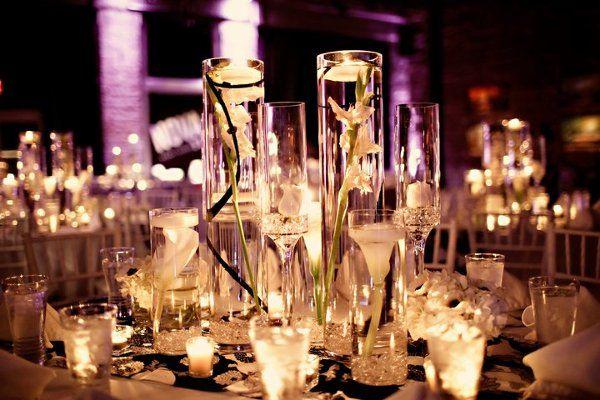 www.weddingsbyiza.com Iza's FLowers, Inc Black and White wedding at Nova 535..... Multiple vases with submerged flowers.....