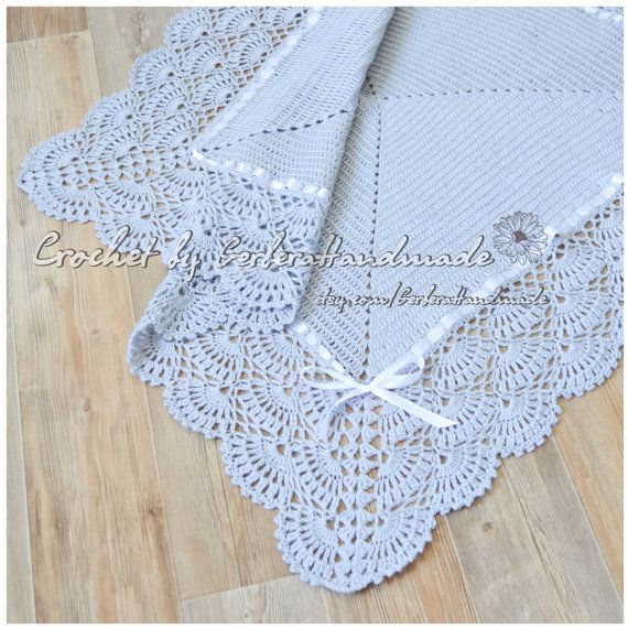Features in the photos is a super soft and cuddly hand crocheted medium blanket for baby with shell stitches. It keeps little ones warm when
