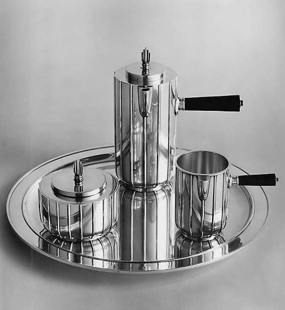 Coffee Pot, Part of Coffee Service by Sigvard Bernadotte (1907 - 2002). Date ca. 1939. Medium: Silver and wood.  Bernadotte was a swedish industrial designer who originally was a prince, until he lost his title when he chose to marry a commoner in 1934. Bernadotte designed in silver for Georg Jensen as well plastic items for the common household. Reference: The Metropolitan Museum of Art. metmuseum. [ Online]. Available: Follow link.