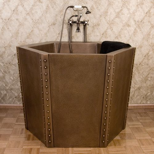 Looks a little like a washtub has a built in seat 48 for Soaking tub with seat