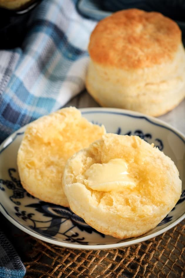 Homemade Cream Biscuits with a dollop of butter. It's all you need. But maybe some honey or jam would be even more amazing. #biscuits #easy
