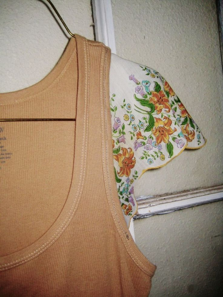 HANKY SLEEVE TANK TOP  Cut the Handkerchief in half diagonally.  Buy a tank top, or use one you already have.  Pin the hanky on both sides and make sure they line up.  Then sew it on and your done.