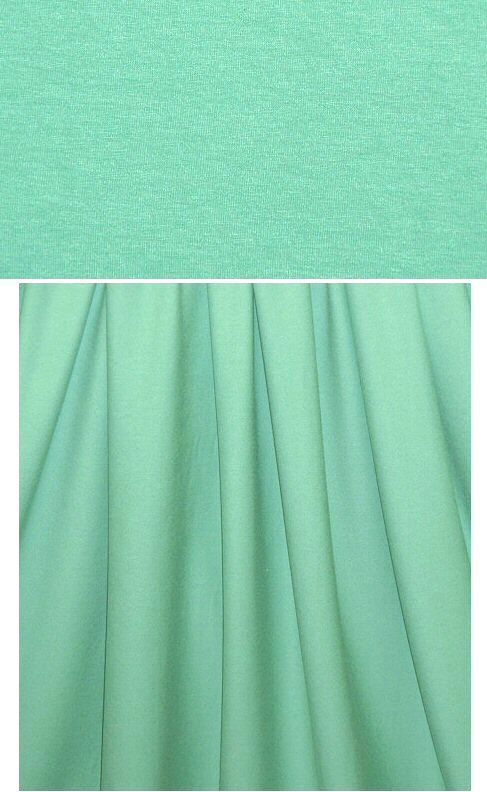(PANTONE 14-5711) A beautiful 11 oz. rayon/lycra single knit jersey in a gorgeous spearmint. 11 oz jersey is a bit lighter weight than the 14 oz, but still works for all the same types of patterns. Rayon/lycra is cool, comfortable, incredibly soft and drapey, has great recovery, and the 11 oz. weight is fabulous for trendy tops and tees, yoga wear, flowy skirt or elastic waist pants, etc. It has about 40% stretch widthwise and lengthwise with great recovery. Machine was
