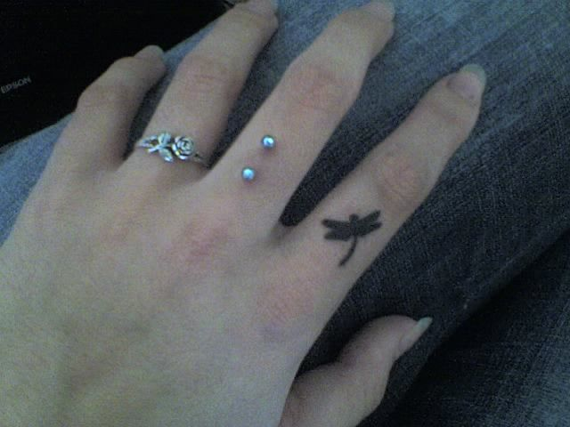 dragonfly finger tattoo.  love it!