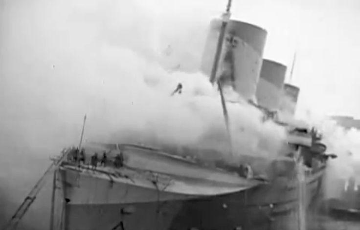 SS Normandie burns.