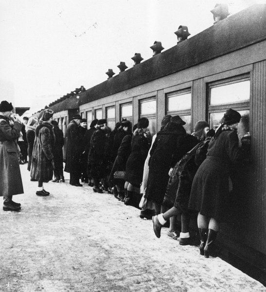 Mothers saying goodbye to their children as they send them off to Sweden so they will be safe during the Winter War. - Finland