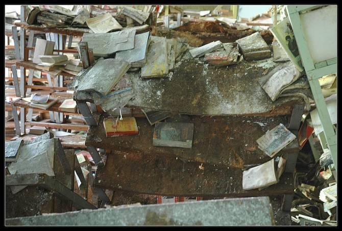 Abandoned Places In The World.  I hate to see books in this state, all the magic draining away.