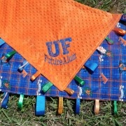 University of Florida Gator blanket made with orange minky dot and ribbon taggy loops.