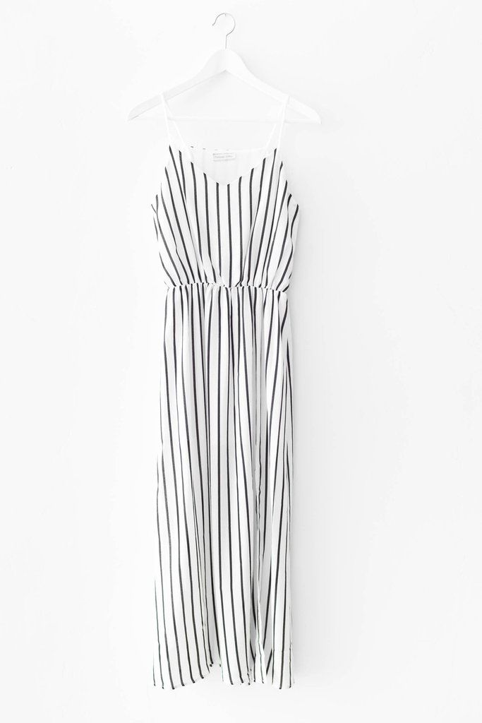 Minimal black and white vertical striped dress. Stretchy and elasticated waistband. Non-stretch woven material. Midi length. 100% Polyester Made in USA