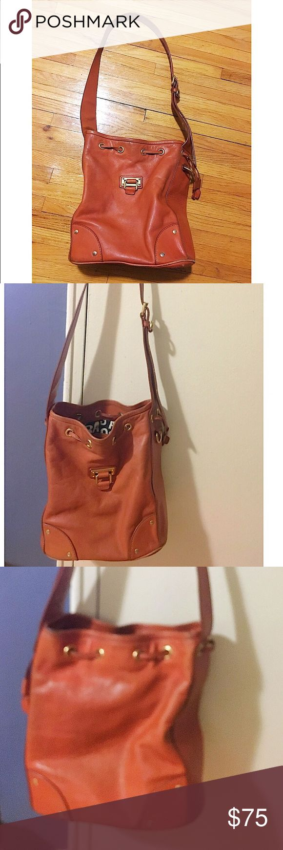 "Marc by Marc Jacobs cognac leather bucket bag This bag has some wear noted but still has plenty of life left. Genuine leather that can be taken to a shoemaker to have it polished and spruced up. Adjustable strap. 36"" strap length. 12"" height, 7"" width, 10"" length. ✅offers❌trades/PP 💰make an offer on bundles Marc by Marc Jacobs Bags Shoulder Bags"