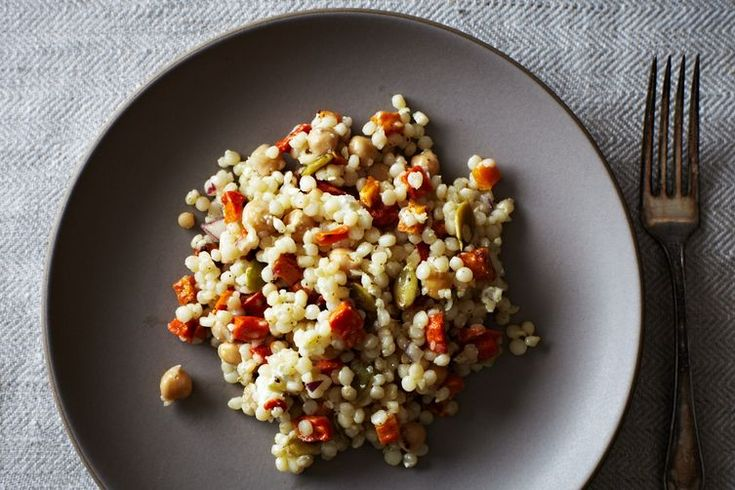 pearl couscous with roasted roots, chickpeas, and pepitas.
