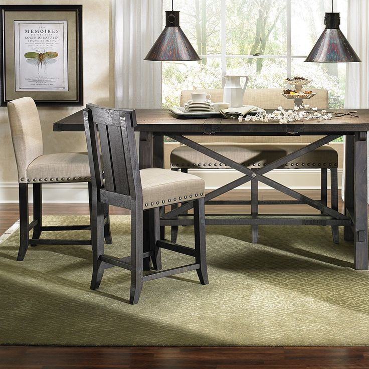 Counter Height Dining Table And Upholstered Chairs In A Weathered Finish With Nail Head Trim Details