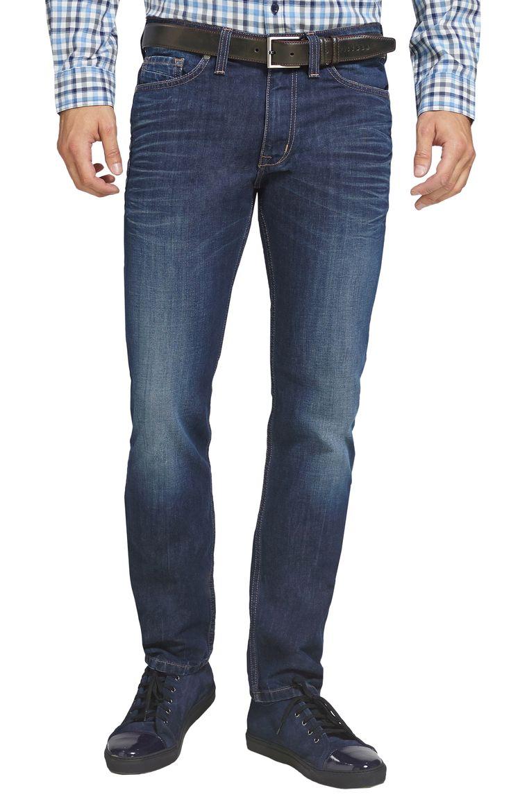 Jeansy granatowe, z przetarciami. Spodnie dżinsowe od Vistuli.
