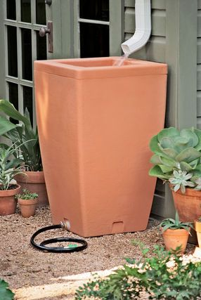 Santa Fe Rain Barrel----- this is a really cool idea to rewater plants or the lawn after a period without rain :0